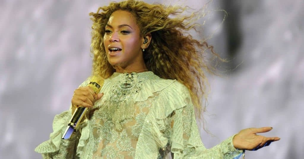 Beyonce passionately performs on stage. Thailand Event Guide